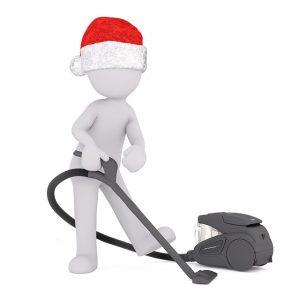 サンタ帽を被った男の人が持つ掃除機