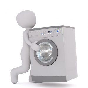洗濯機を持ち上げる人